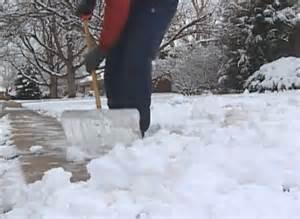 Photo of person shoveling snow